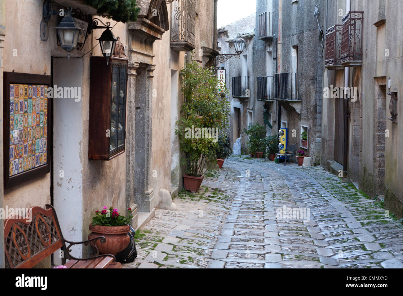 View down narrow cobbled street, Erice, Sicily, Italy, Europe - Stock Image
