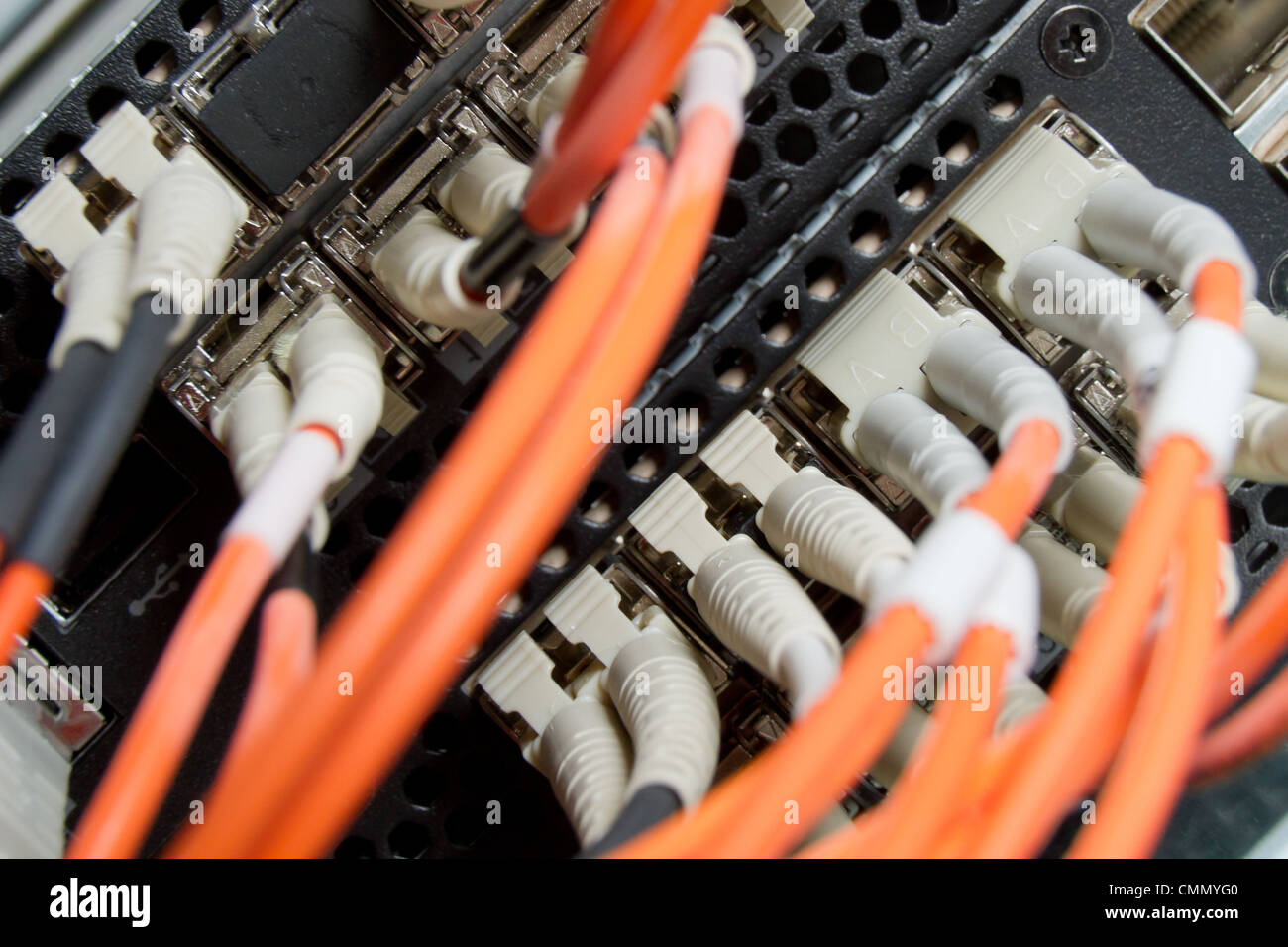 optic fiber cables connected to data center - Stock Image