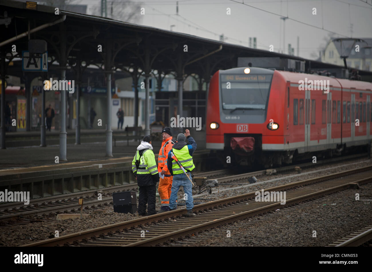 Rail engineers working on trackside signals, Solingen, North Rhine-Westphalia, Germany. Stock Photo