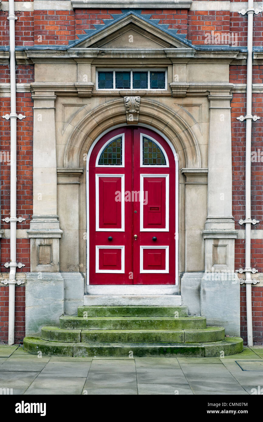 An imposing red Victorian, neo 17th century Dutch door - Stock Image