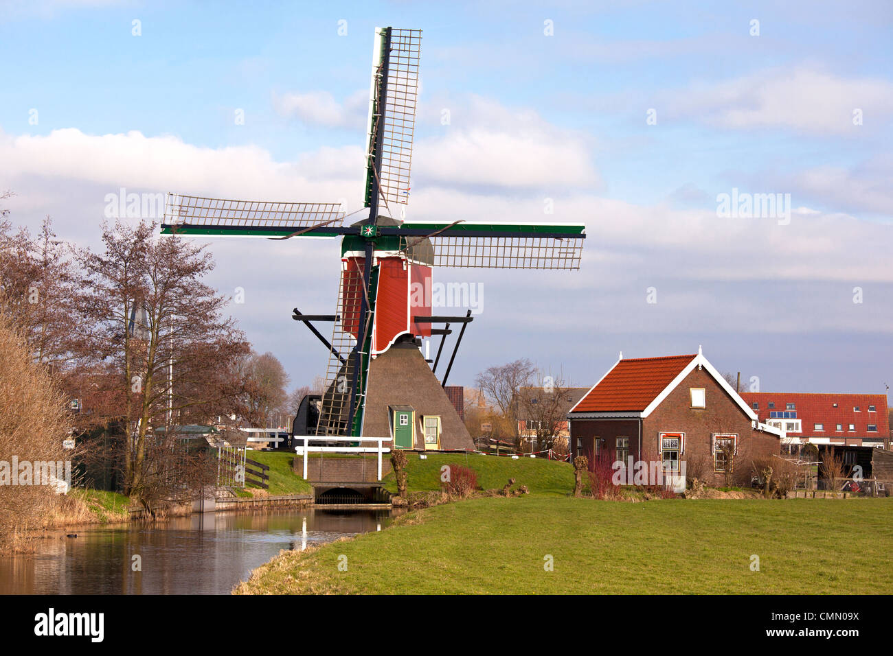 Wooden Windmill in Dutch landscape - Stock Image