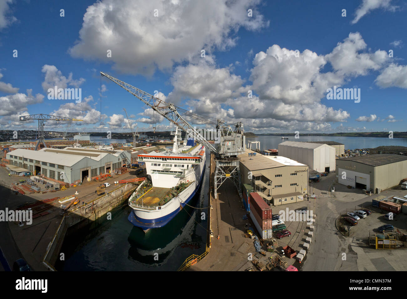 Falmouth dockyard and dry dock with the P&O MS Pride of Calais ferry being refitted. - Stock Image