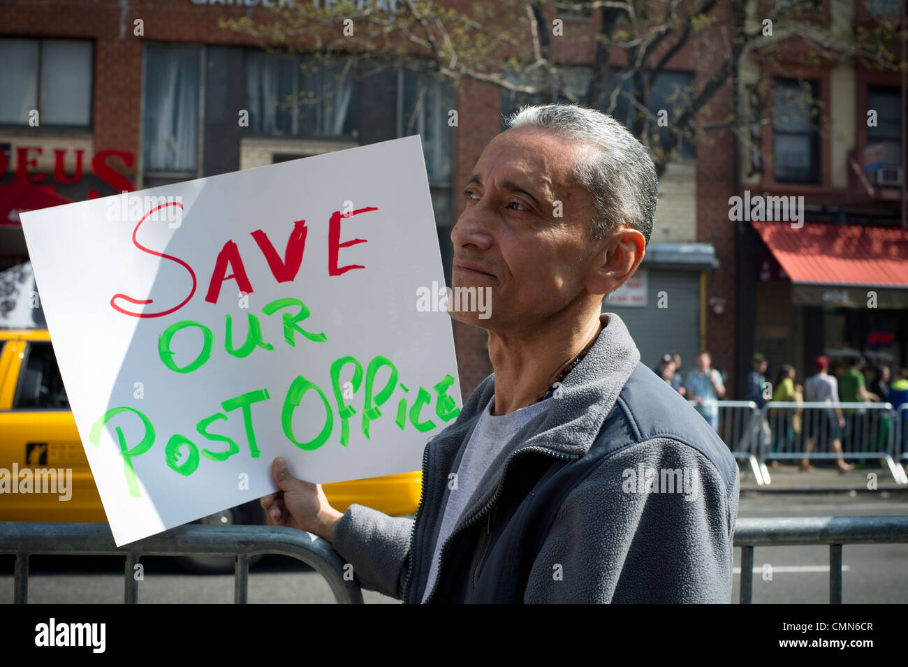 Postal workers and supporters rally to demand that the USPS continue six-day a week mail delivery service - Stock Image