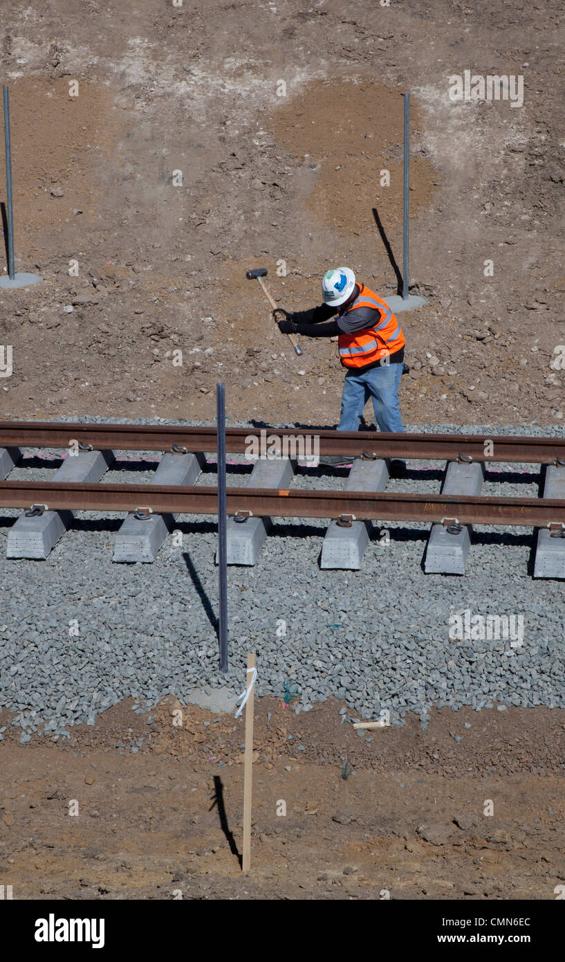 Lakewood, Colorado - Workers build a light rail urban transit system linking Denver with its western suburbs. - Stock Image