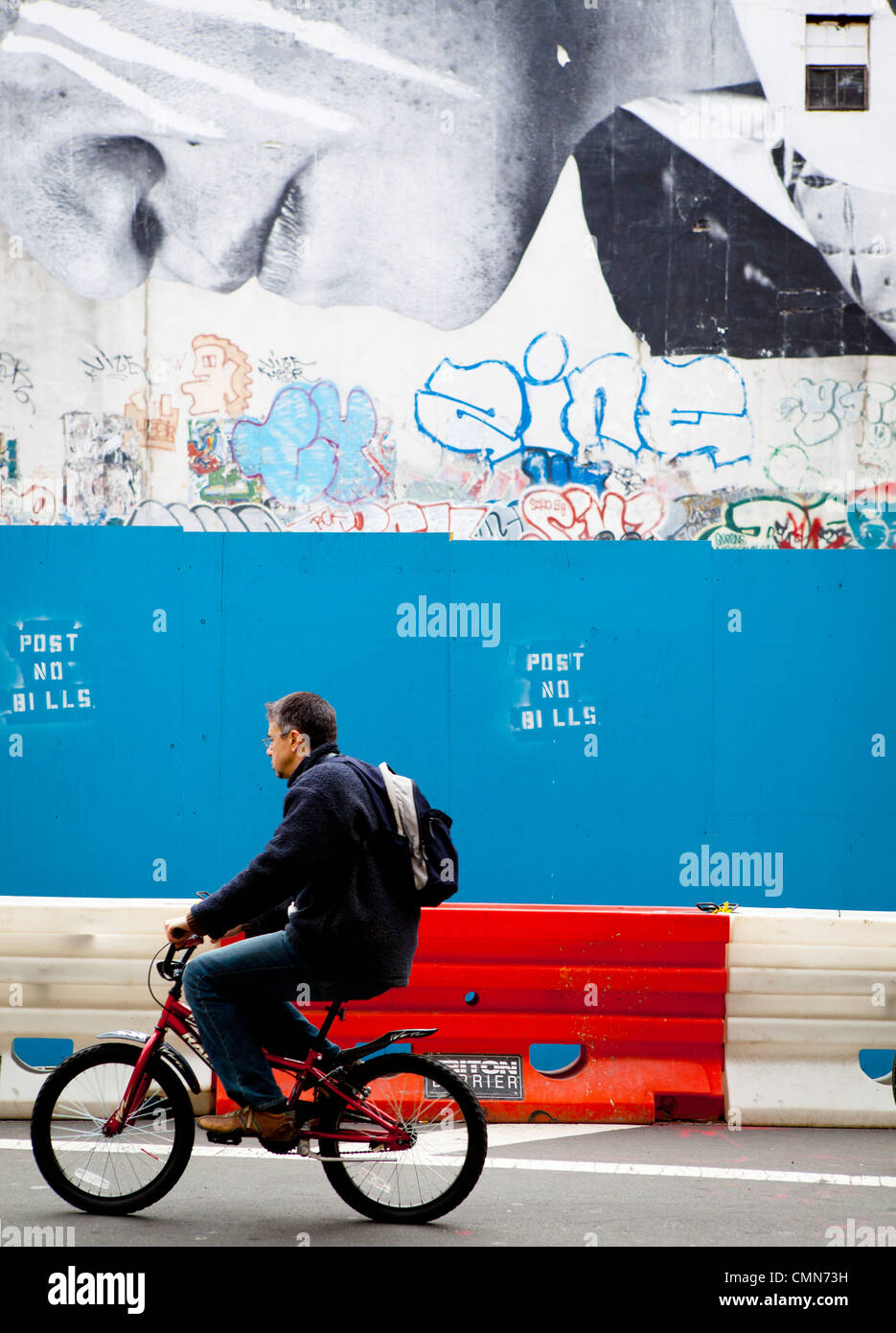man on bike with billboard, New York Stock Photo