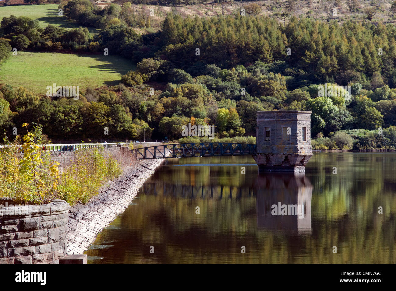 Talybont reservoir, dam and water tower with reflection at Brecon Beacons in Wales taken on beautiful bright sunny - Stock Image