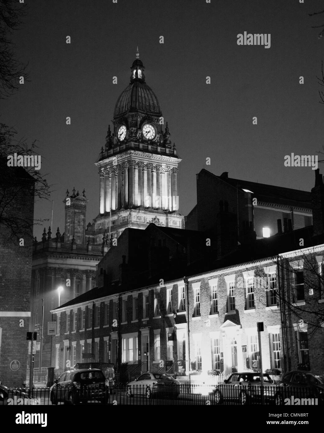 A black and white night shot of Leeds town hall from Park square - Stock Image