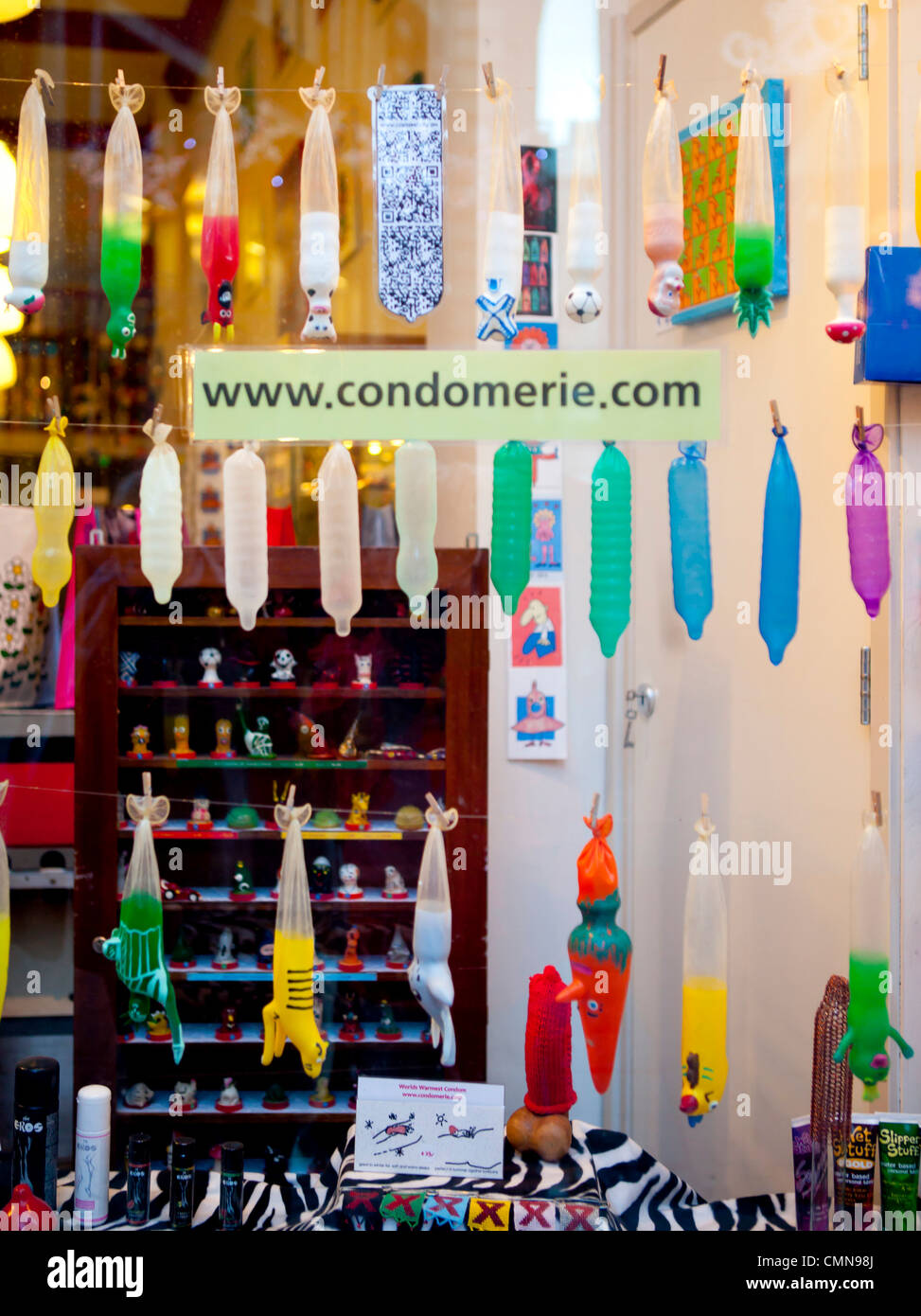 condom shop window, Amsterdam - Stock Image
