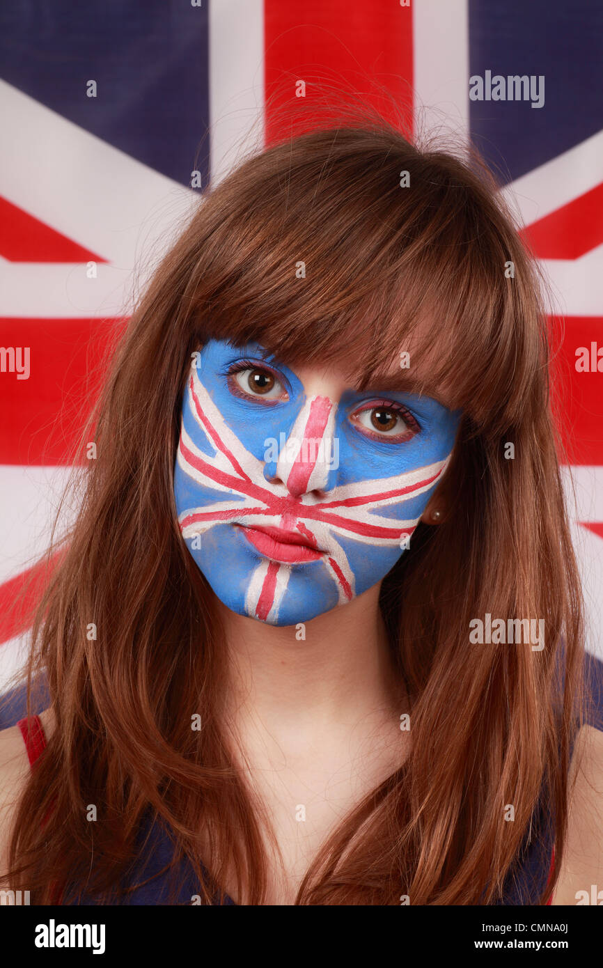 Young Girl with Face Painted in front of a Union Jack Flag - Stock Image