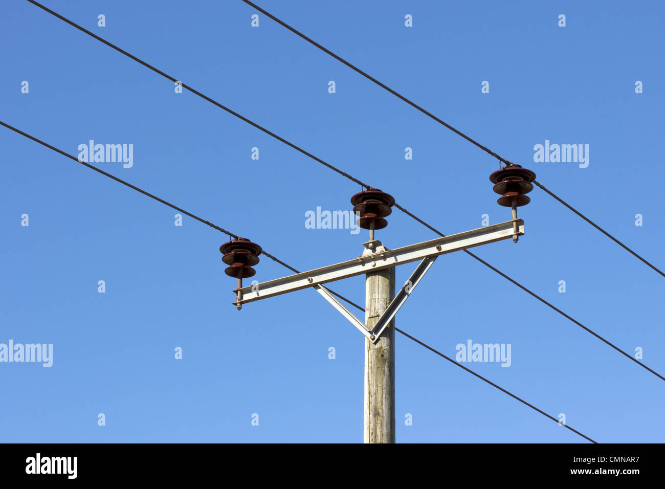 Electricity pole with overhead cables, UK - Stock Image
