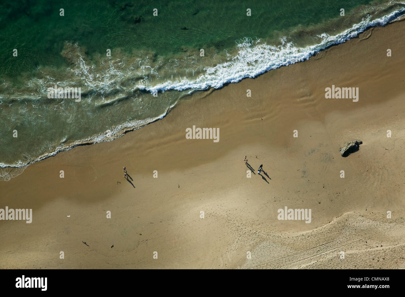 Aerial Photography People Walking On California Beach