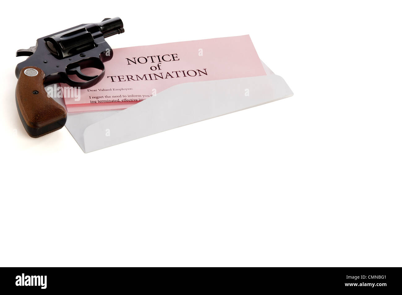 Pink slip termination notice lies on white background with a gun lying on top of it - Stock Image