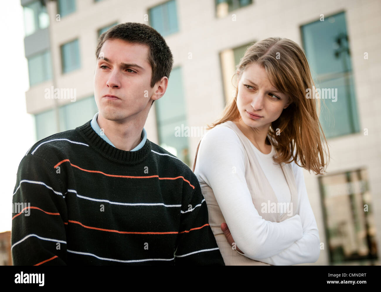 Portrait of young woman and man outdoor on street having relationship problems - Stock Image