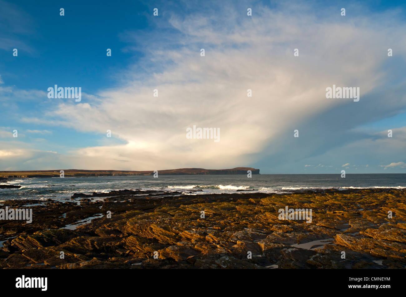 Cumulonimbus shower cloud over Dunnet Head  and the Pentland Firth, Caithness, Scotland, UK. - Stock Image
