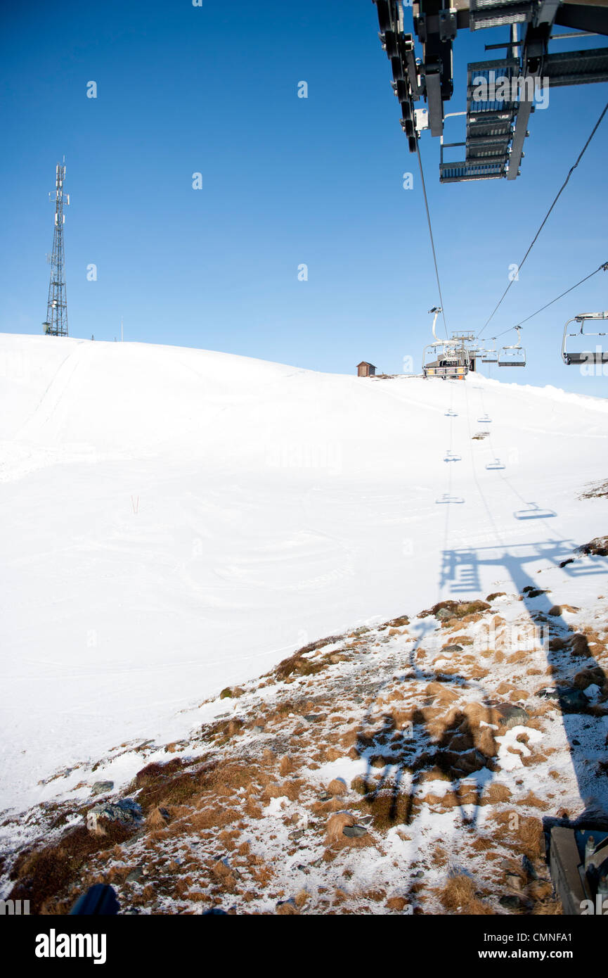 Lift moving up to the peak of Noose mountain, main skiing area of the Hovden alpine center in Hovden, South Norway - Stock Image