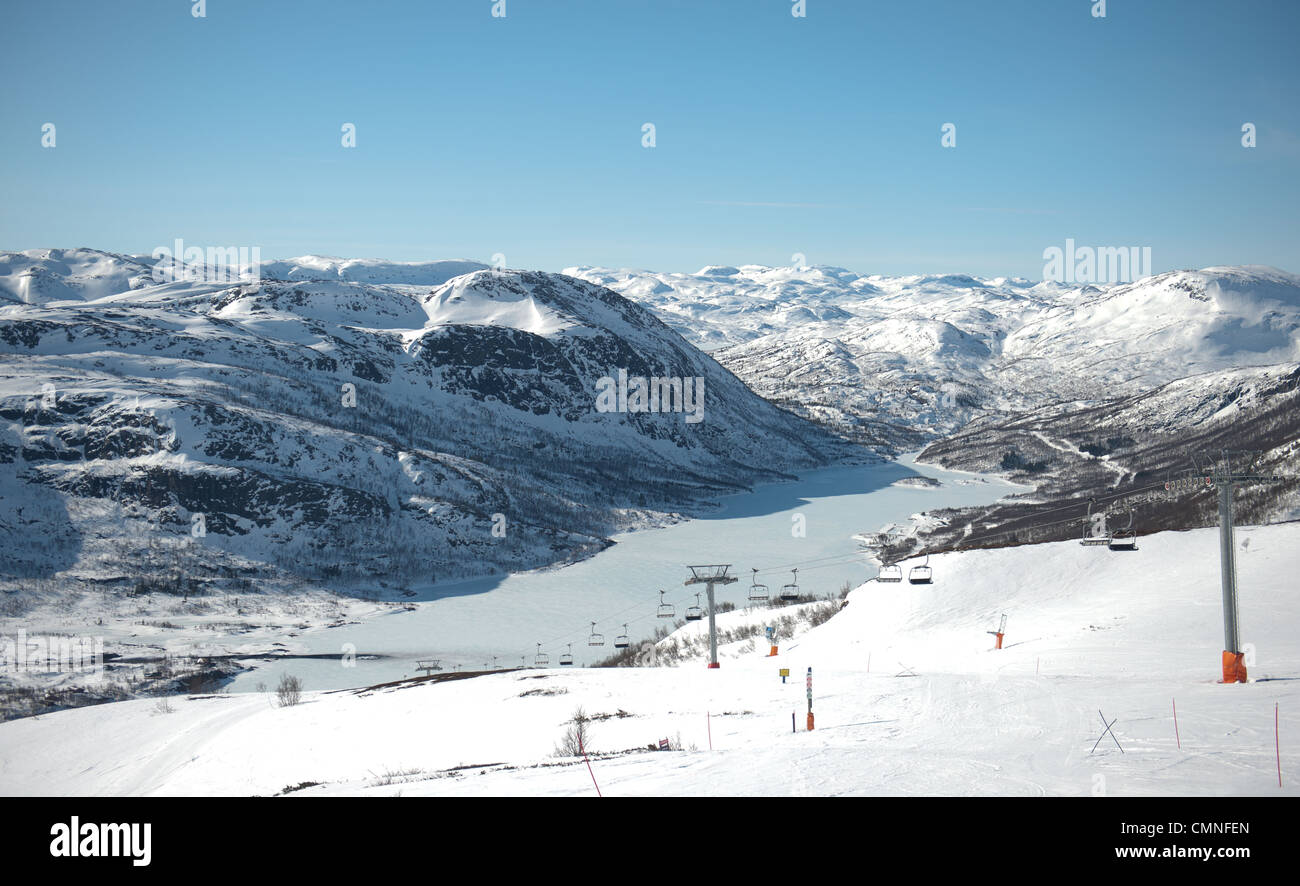 Looking down from the ski slopes of Noose mountain to the village of Hovden and Breivevatnet in Aust-Agder, southern - Stock Image