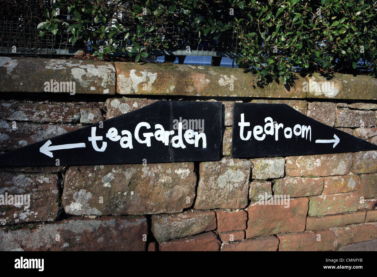 Tearoom and tea garden sign on a dry stone wall in the Lake District - Stock Image