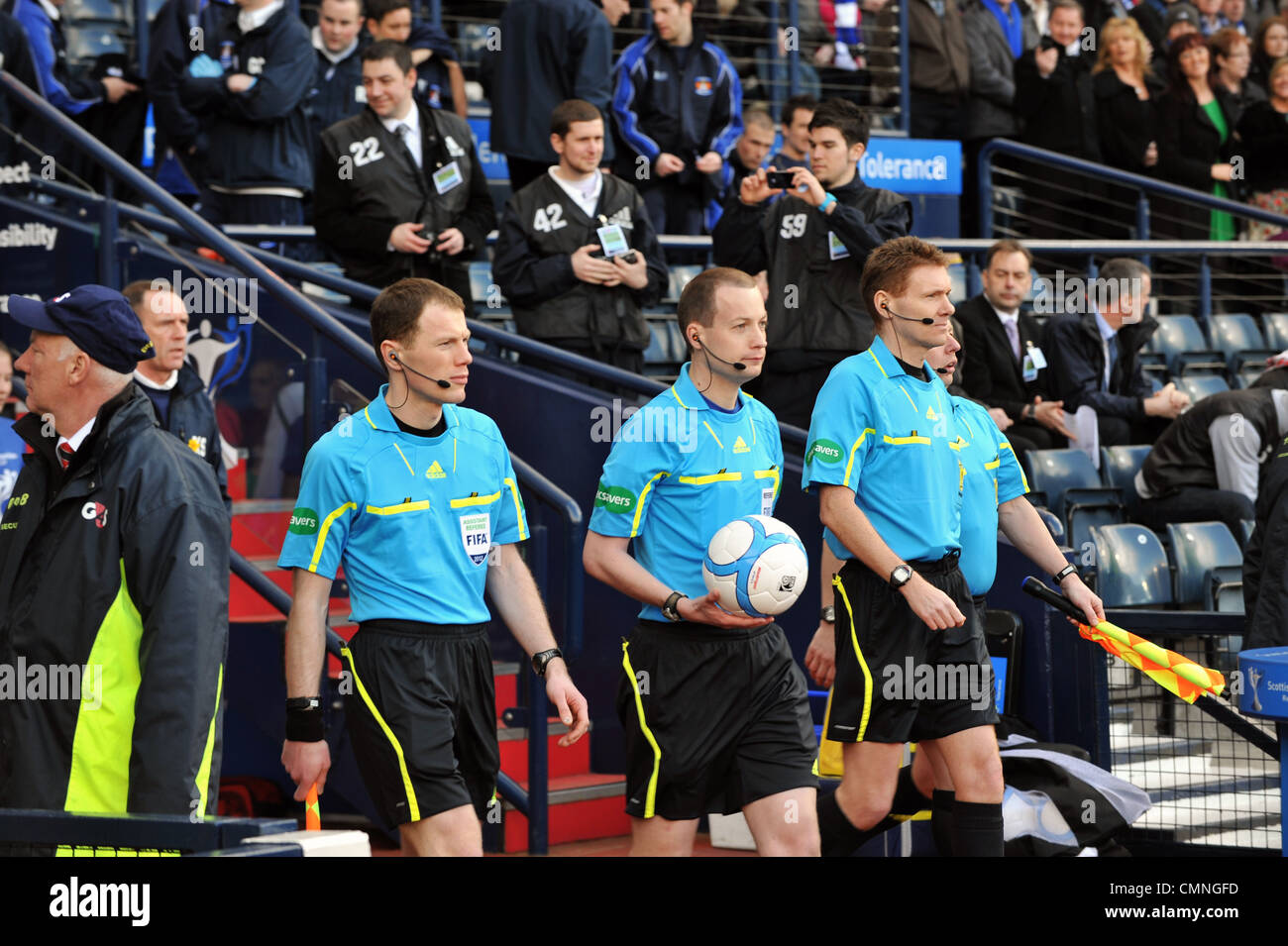 Referee Willie Collum (with ball) and assistant referees Stuart Stevenson, Calum Murray and Charlie Smith. - Stock Image