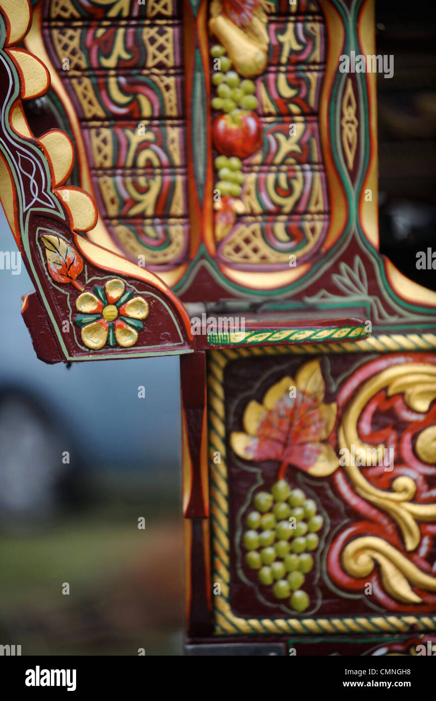 Detail of the decoration on a horse drawn caravan or Gypsy wagon at the Stow-on-the-Wold horse fair May 2009 UK - Stock Image