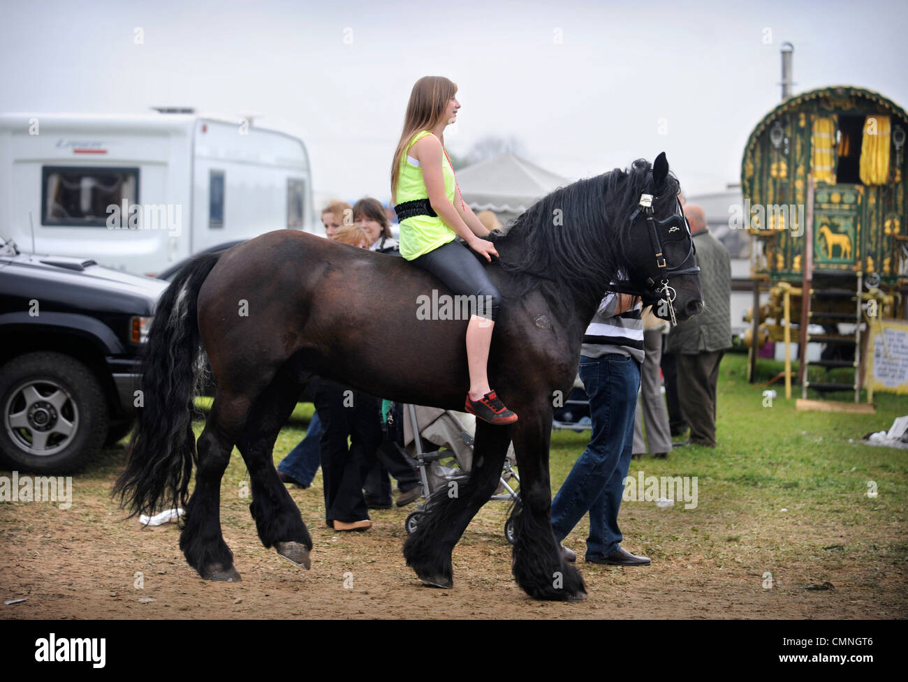 A girl riding a cart horse at the Stow-on-the-Wold horse fair May 2009 UK - Stock Image
