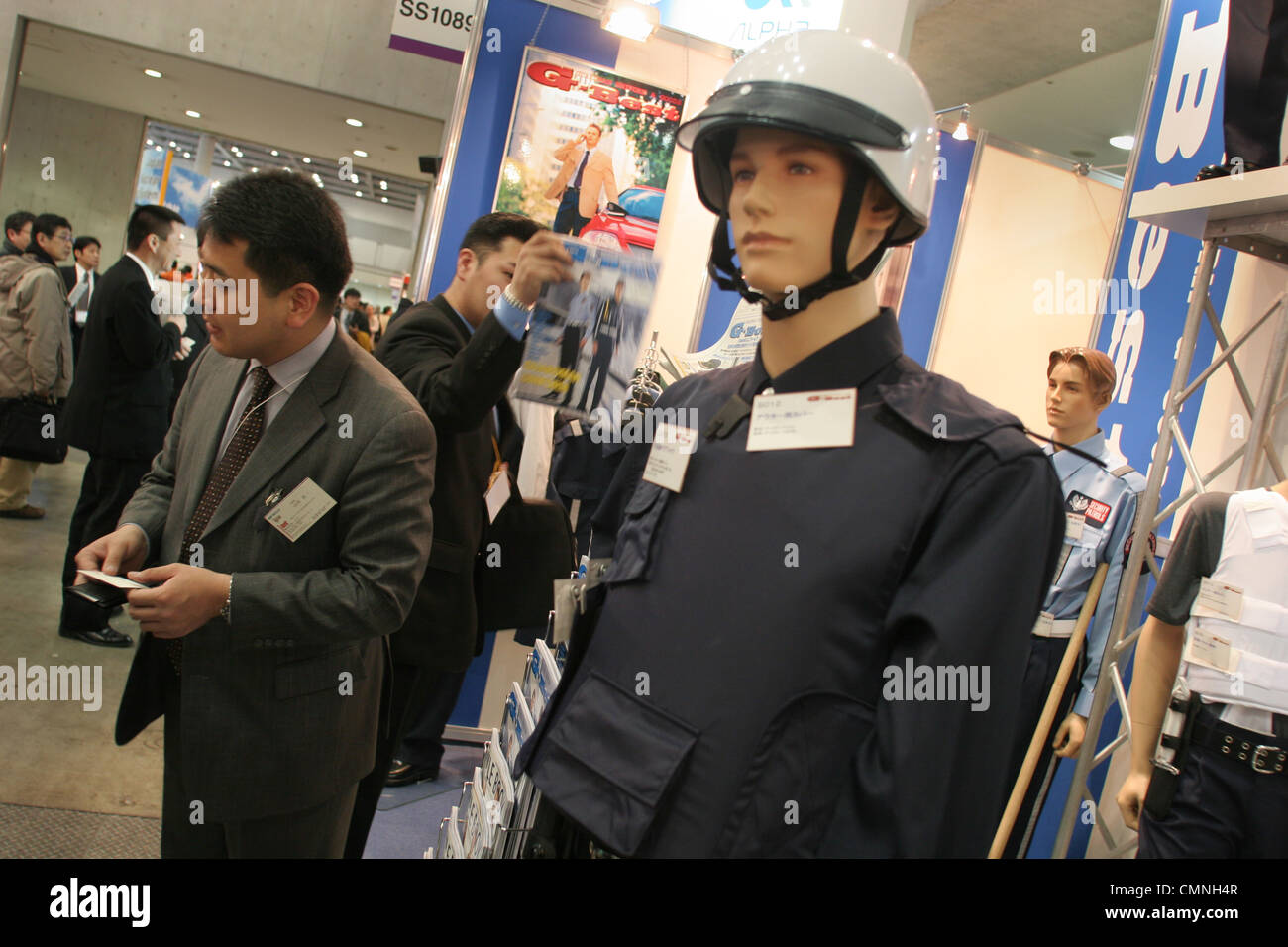 Security personnel uniforms and clothing on display at 'Security Show' in Tokyo, Japan. - Stock Image