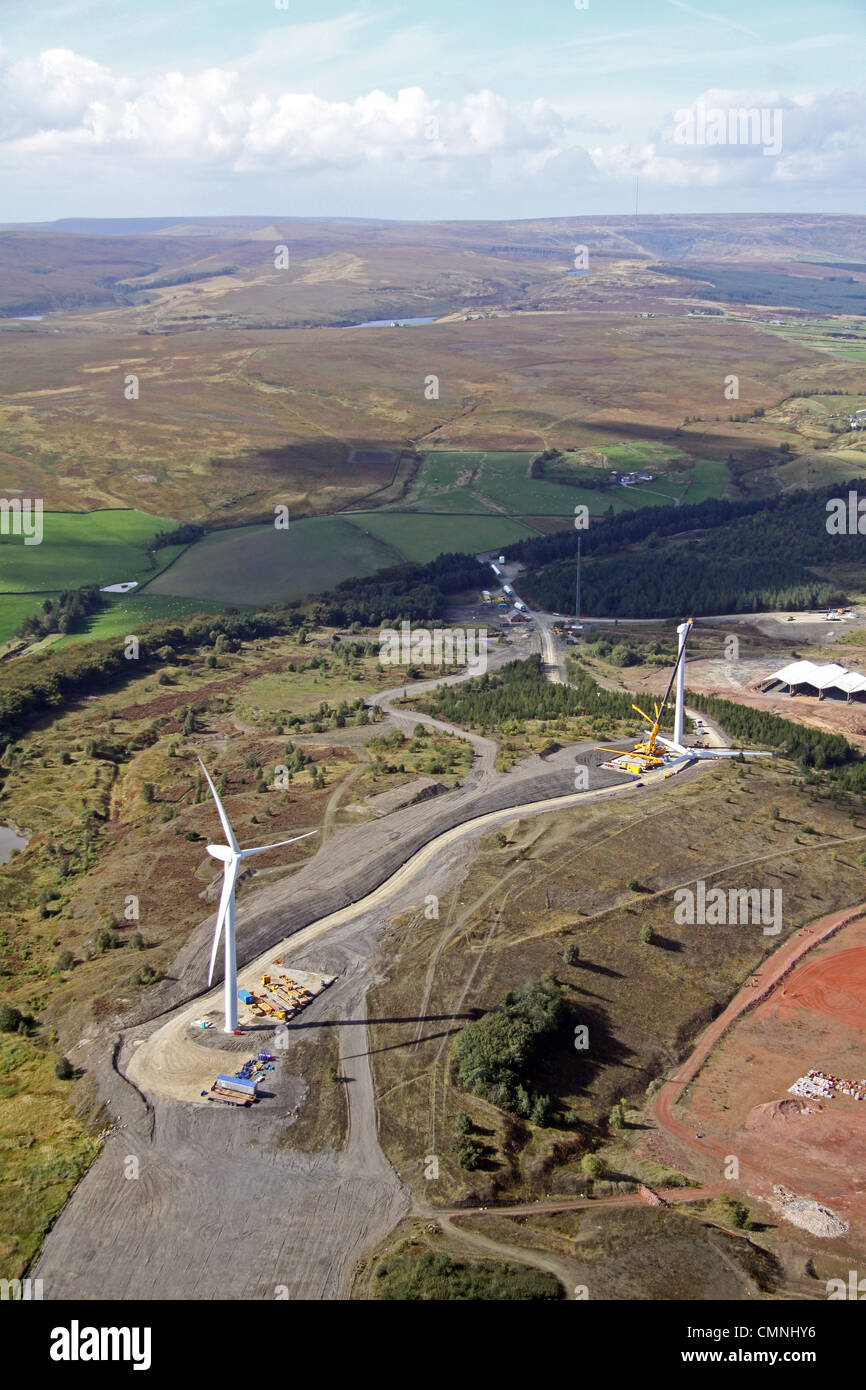 Aerial view of two wind turbines under construction - Stock Image