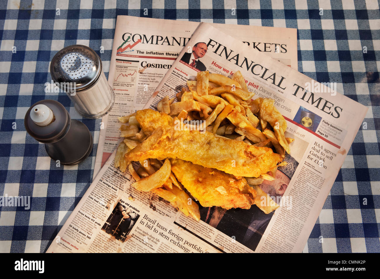 Traditional fish and chips served on the Financial Times - Stock Image