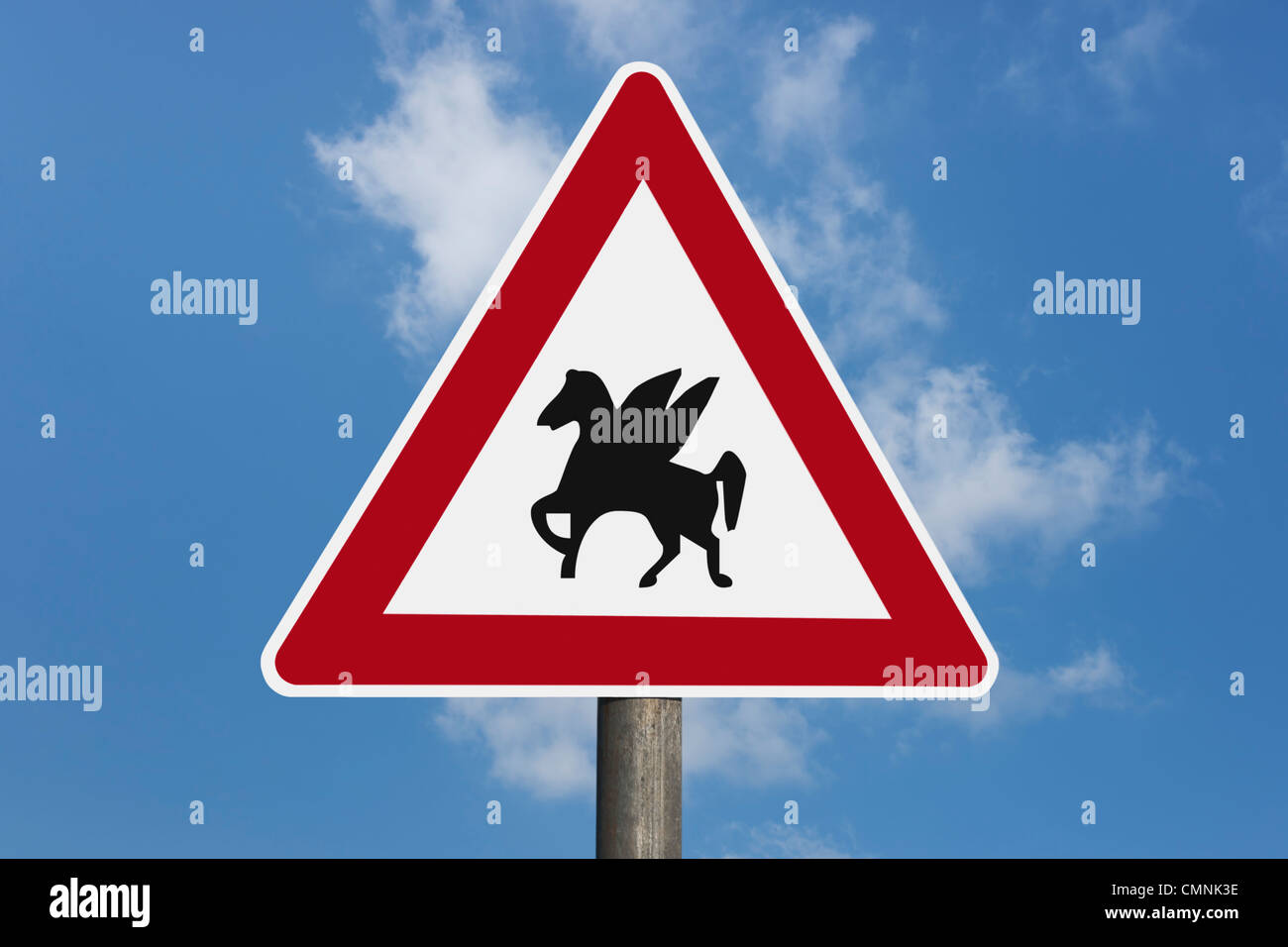 Detail photo of a danger sign with the winged horse Pegasus in the middle, background sky. - Stock Image