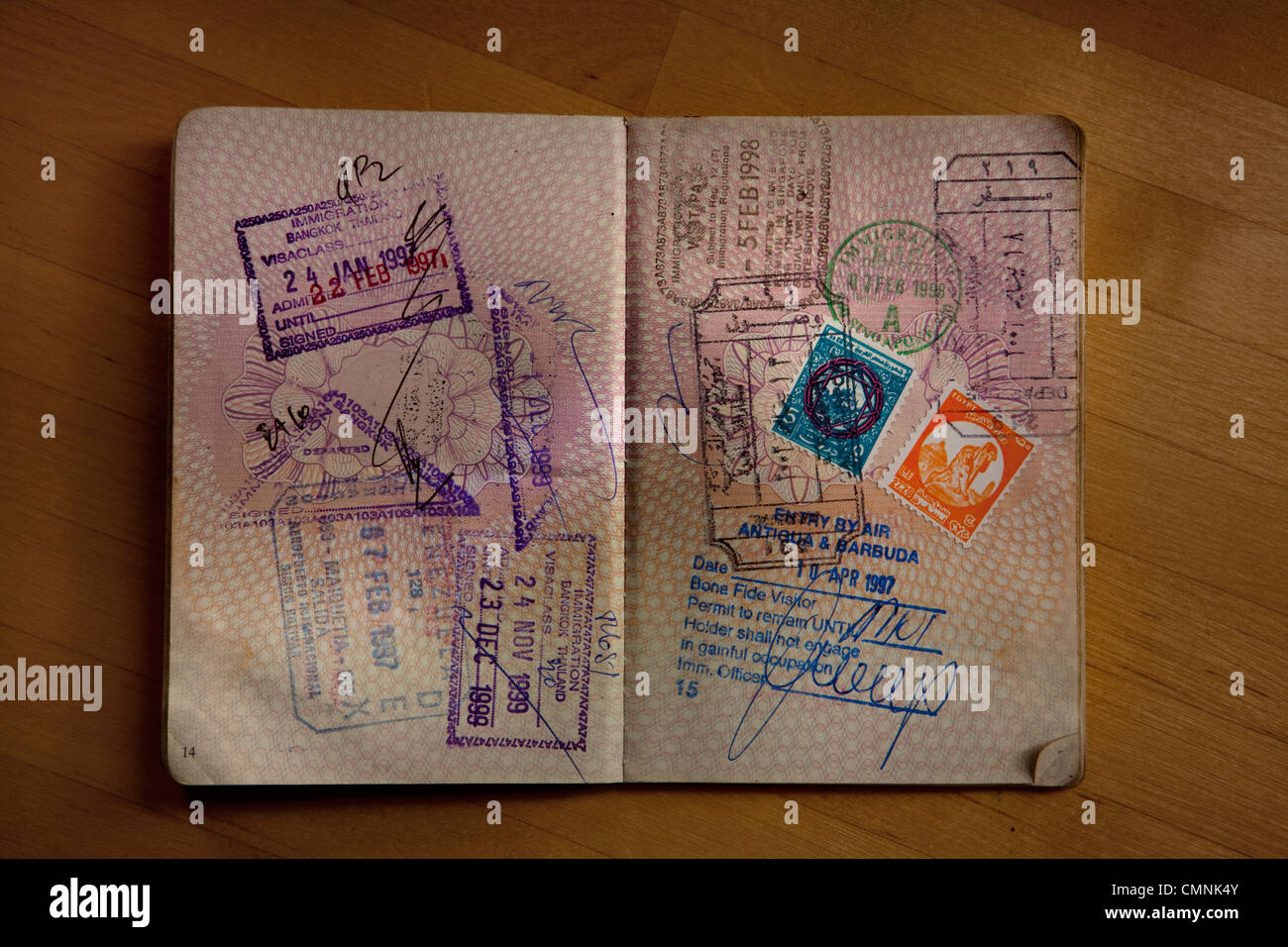 Passport pages with international stamps - Stock Image