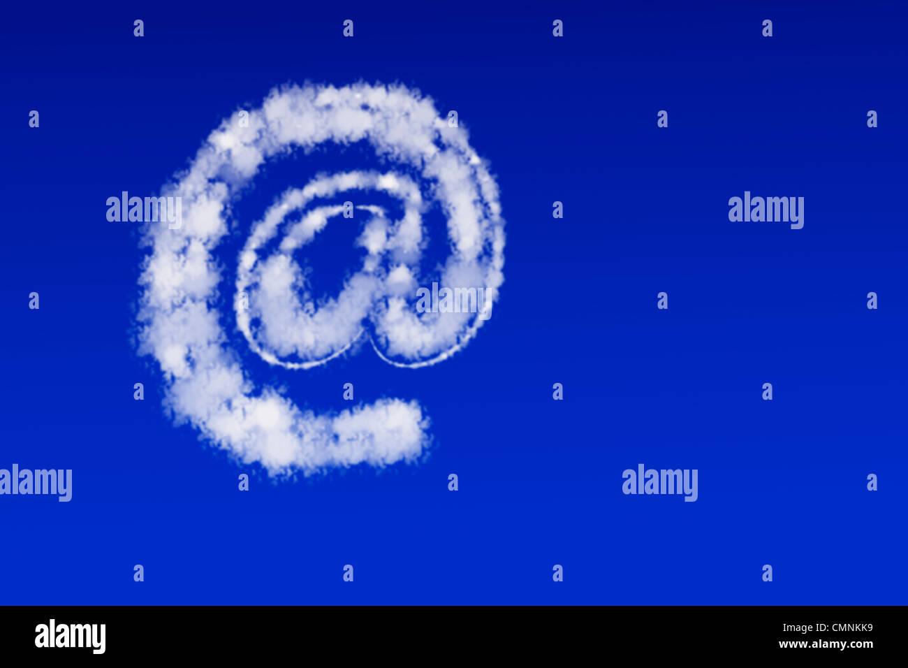 Wolken in Form eines At Zeichen schweben am blauen Himmel   Clouds in the form of a At sign floating in the blue - Stock Image