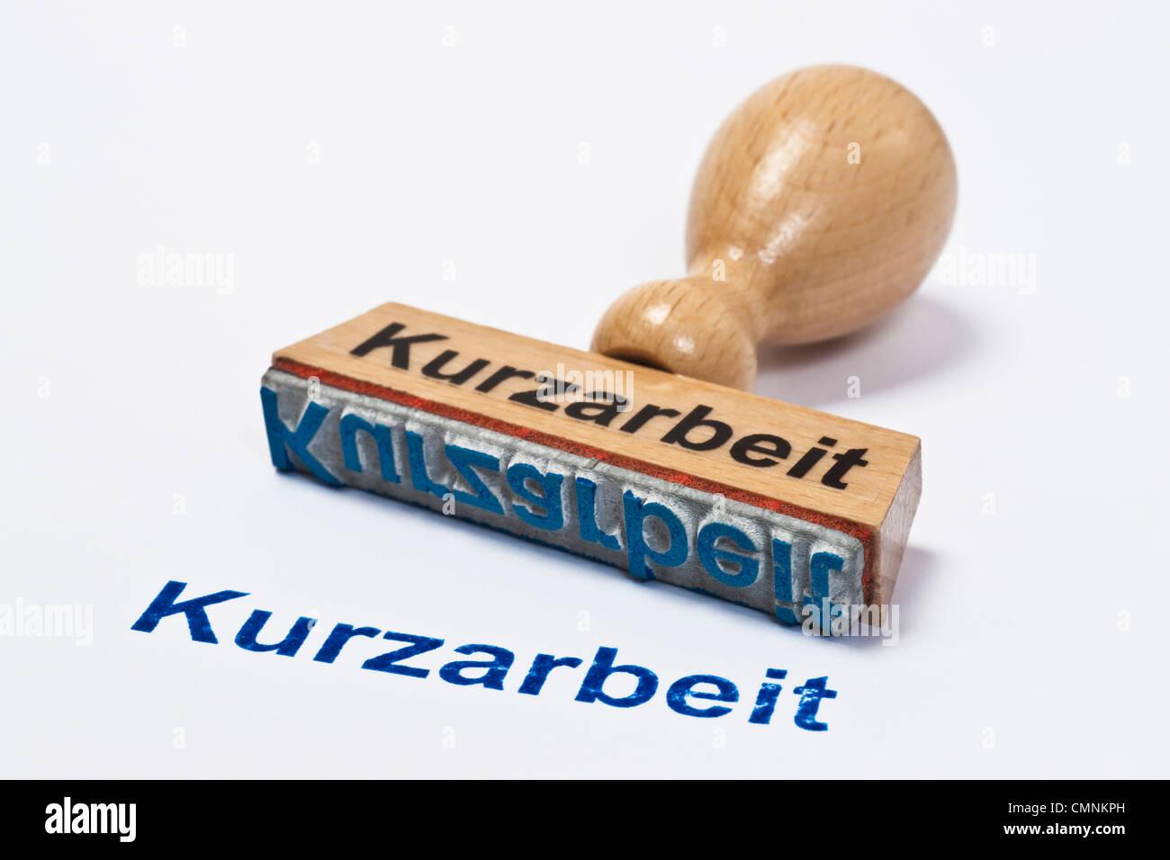 Detailansicht eines Stempels mit der Aufschrift Kurzarbeit | Detail photo of a stamp with inscription in German Stock Photo