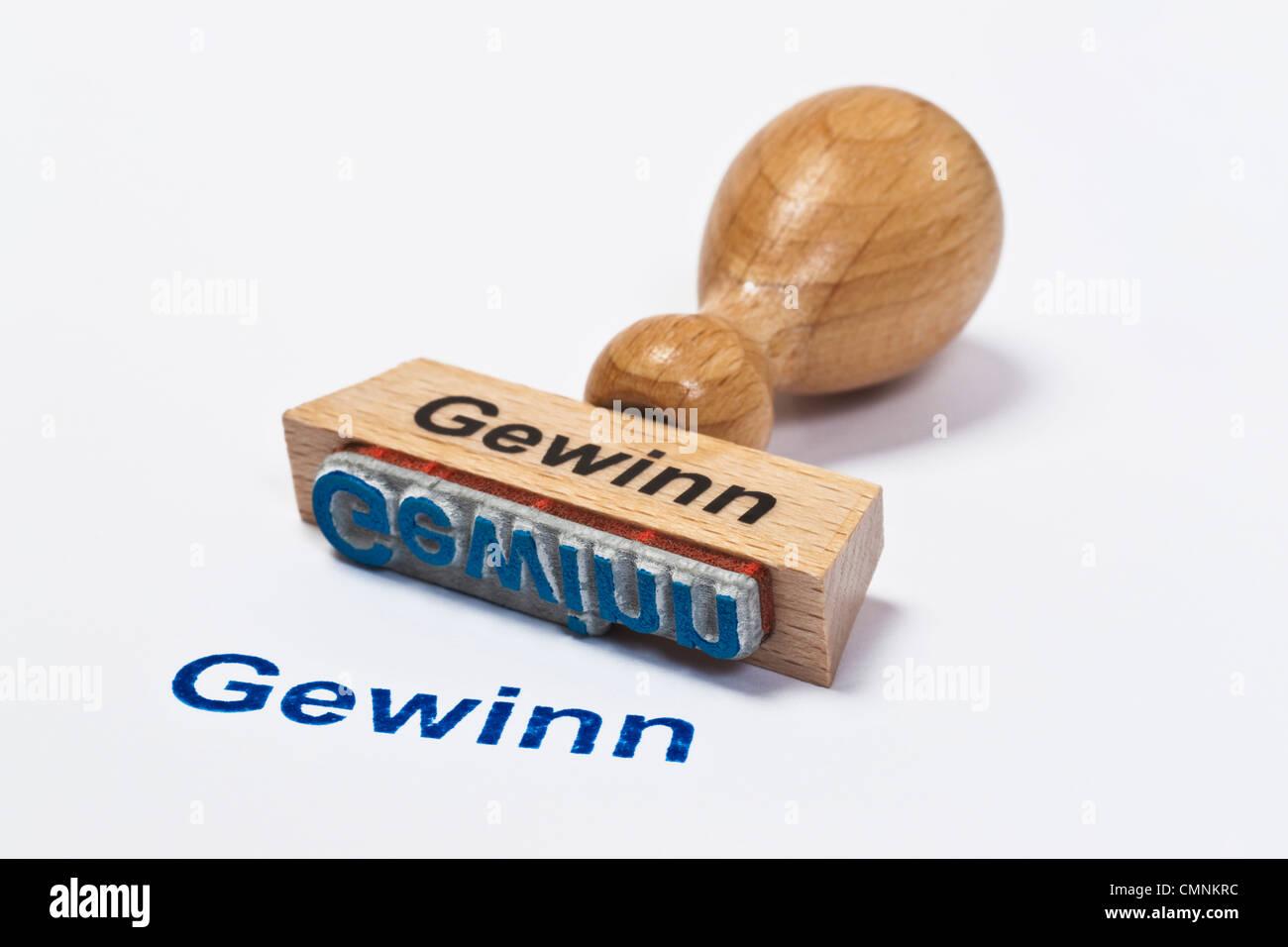 Detailansicht eines Stempels mit der Aufschrift Gewinn | Detail photo of a stamp with inscription in German profit Stock Photo