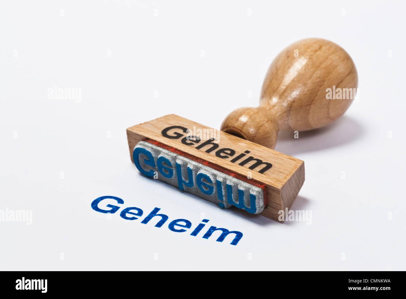 Detailansicht eines Stempels mit der Aufschrift Geheim   Detail photo of a stamp with inscription in German secret - Stock Image