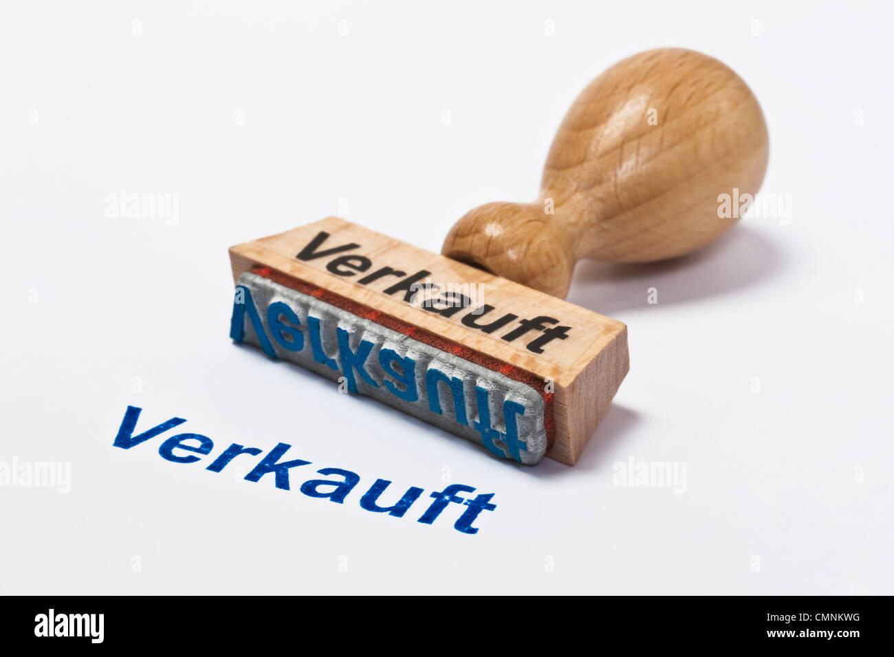 Detailansicht eines Stempels mit der Aufschrift Verkauft | Detail photo of a stamp with inscription in German sold Stock Photo