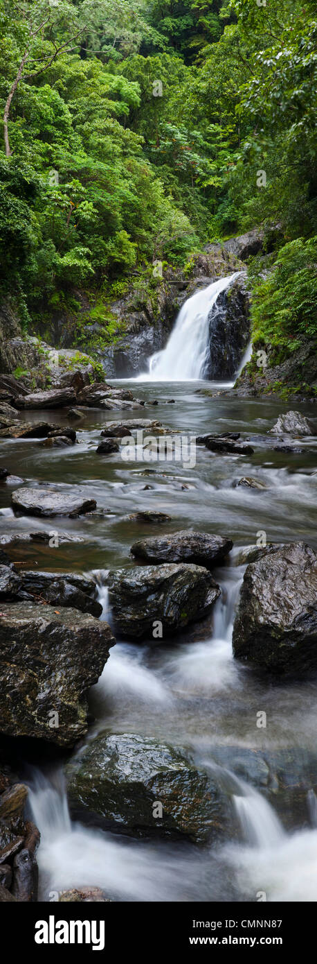 Waterfall at Crystal Cascades - a popular freshwater swimming hole near Cairns, Queensland, Australia - Stock Image