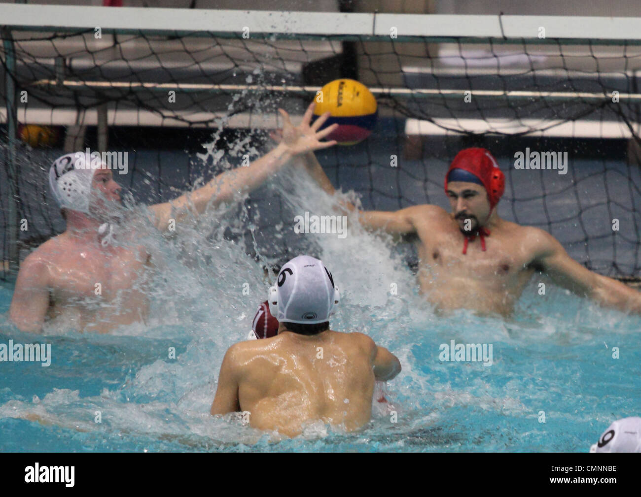 Water polo between Sheffield University and Sheffield Hallam University during the Varsity 2012 sports event. - Stock Image