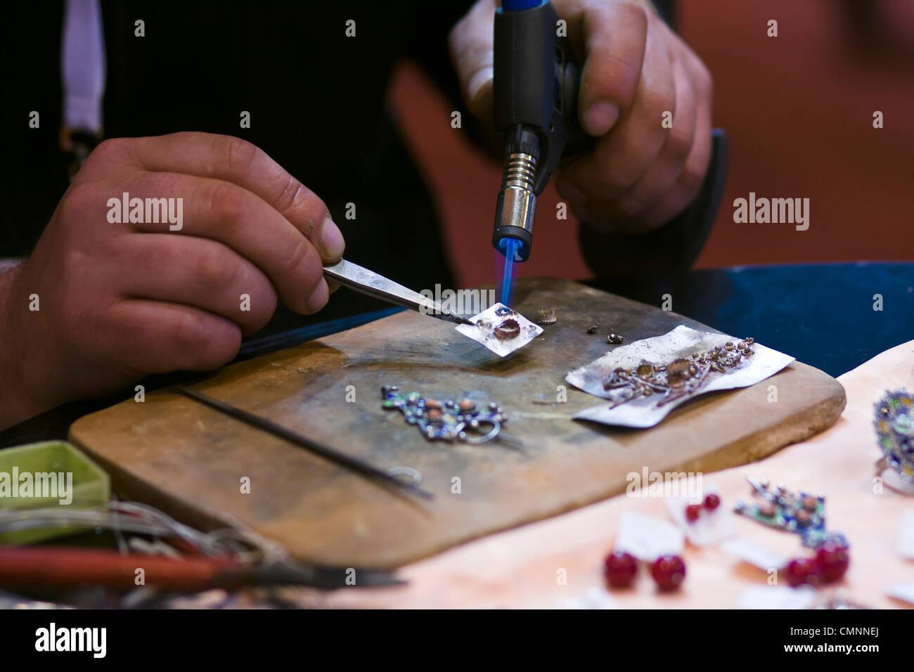 Egyptian jeweller at work International Tourism Show 2012 Paris - Stock Image