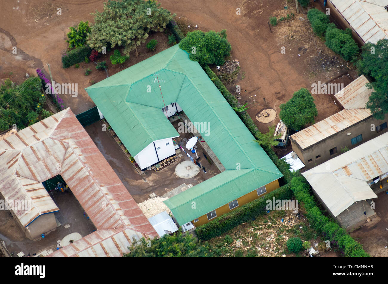House and courtyard with satellite dish, aerial view, Moshi Stock ...