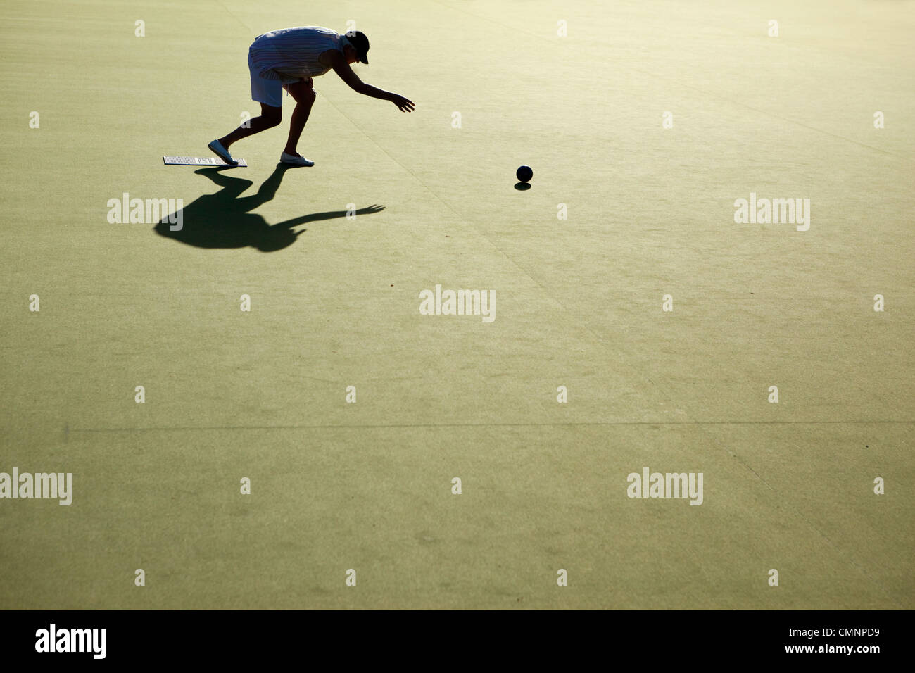 Woman playing lawn bowls. Cooktown, Queensland, Australia - Stock Image