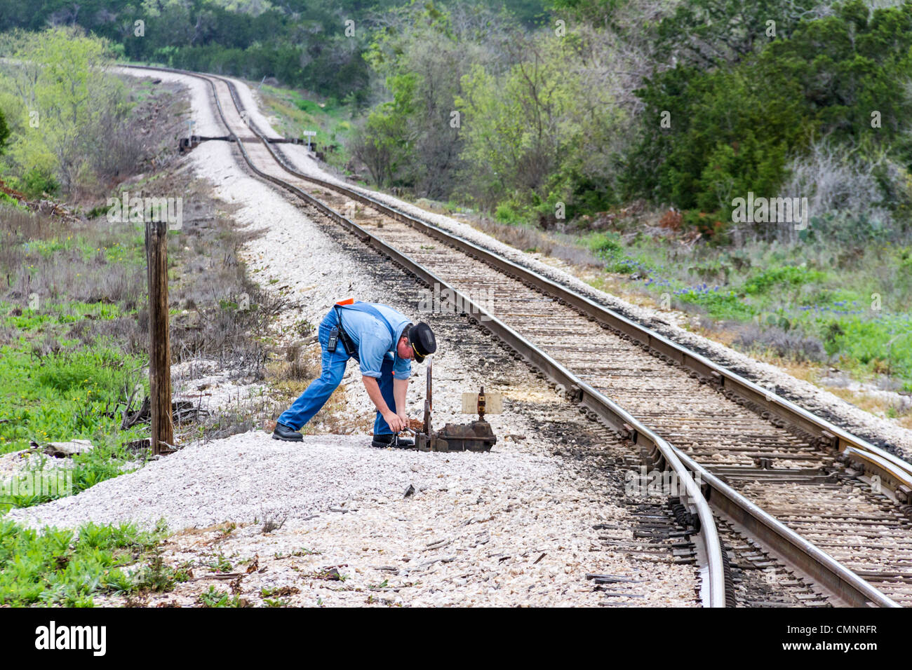 Brakeman walks ahead to operate switches to change tracks on Austin and Texas Central RR. - Stock Image