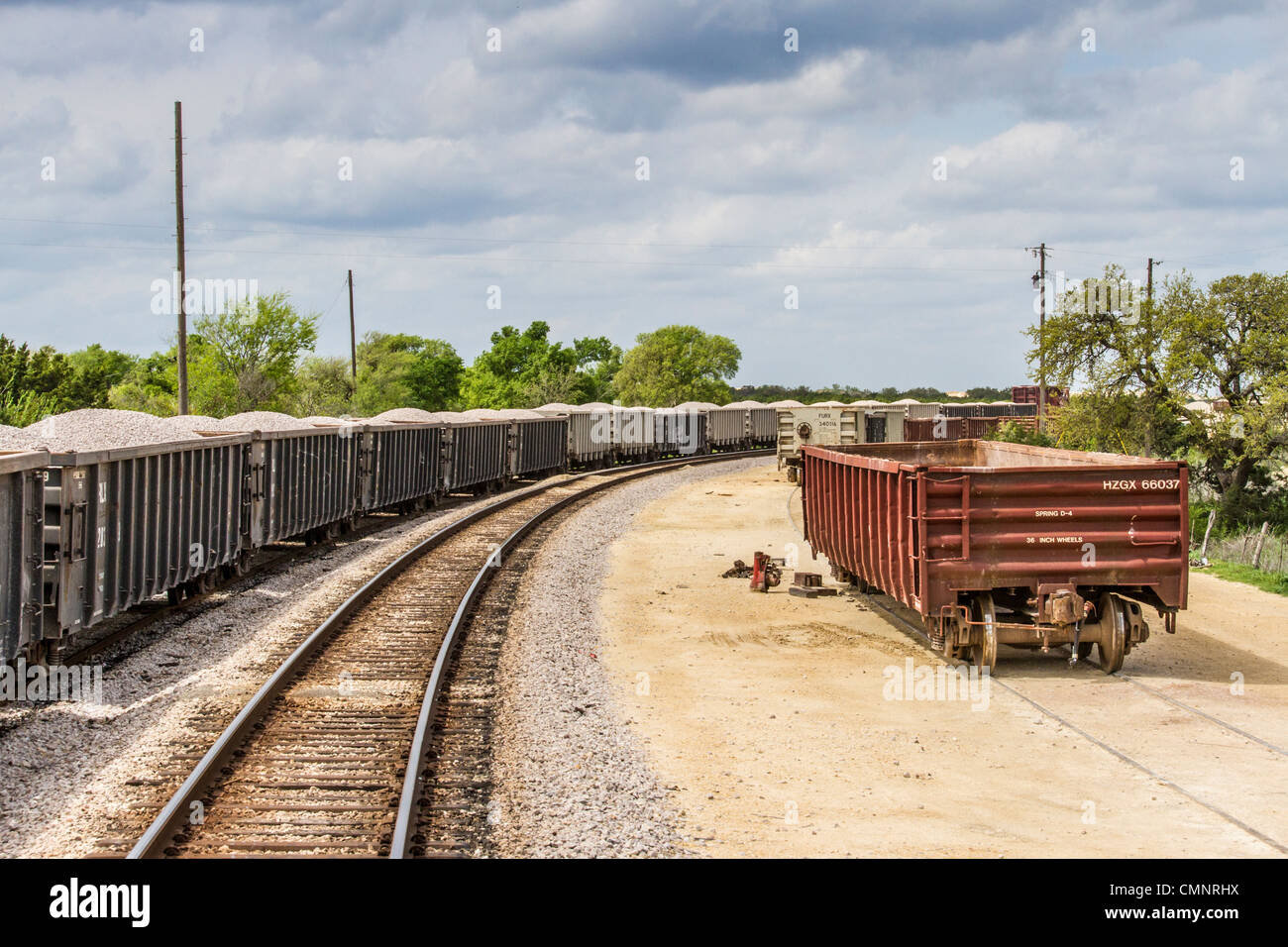 Train tracks and parked freight rail cars along Central