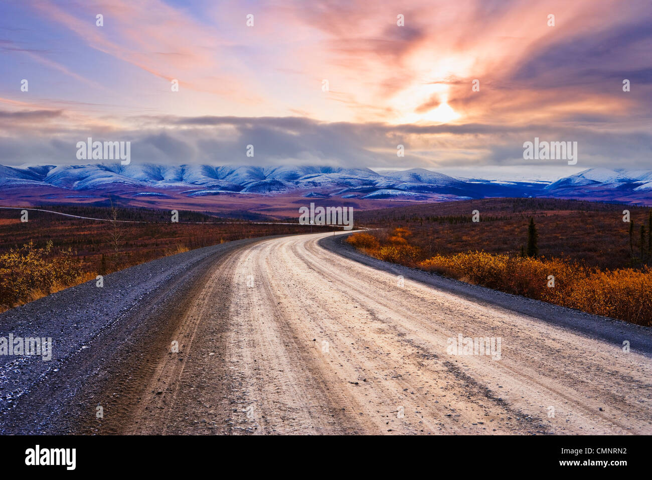 Dempster Highway, Arctic Circle and Richardson Mountains at sunrise, Yukon - Stock Image