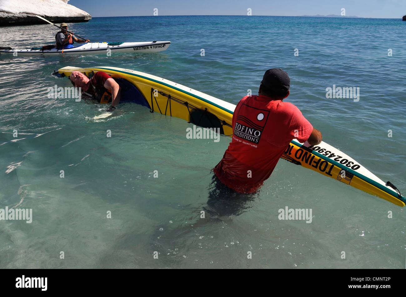 Guide teaching how to roll a sea kayak, Sea of Cortez, Loreto Bay National Park, Baja California, Mexico. - Stock Image