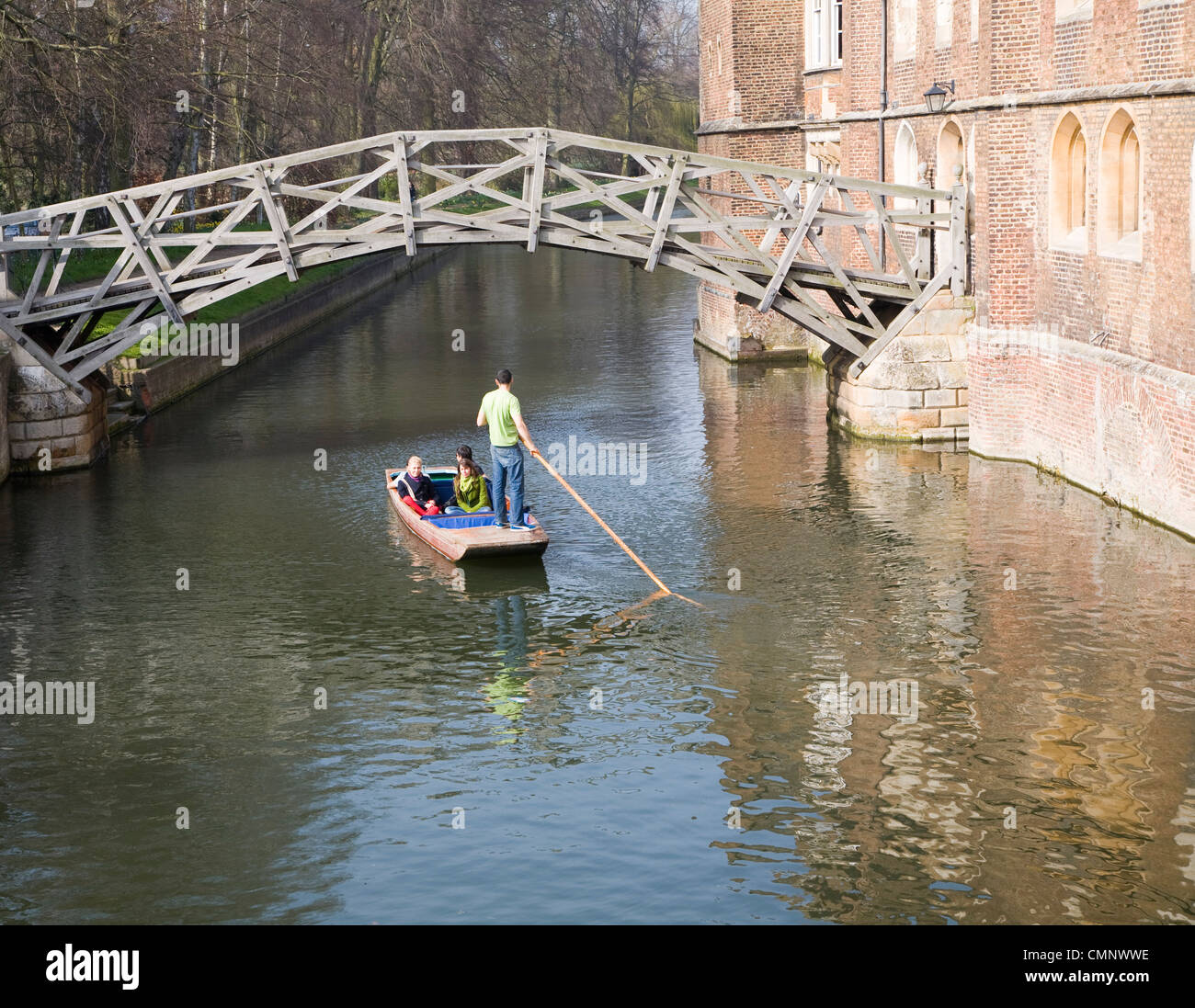 People punting on the River Cam by the Mathematical Bridge, Cambridge, England Stock Photo