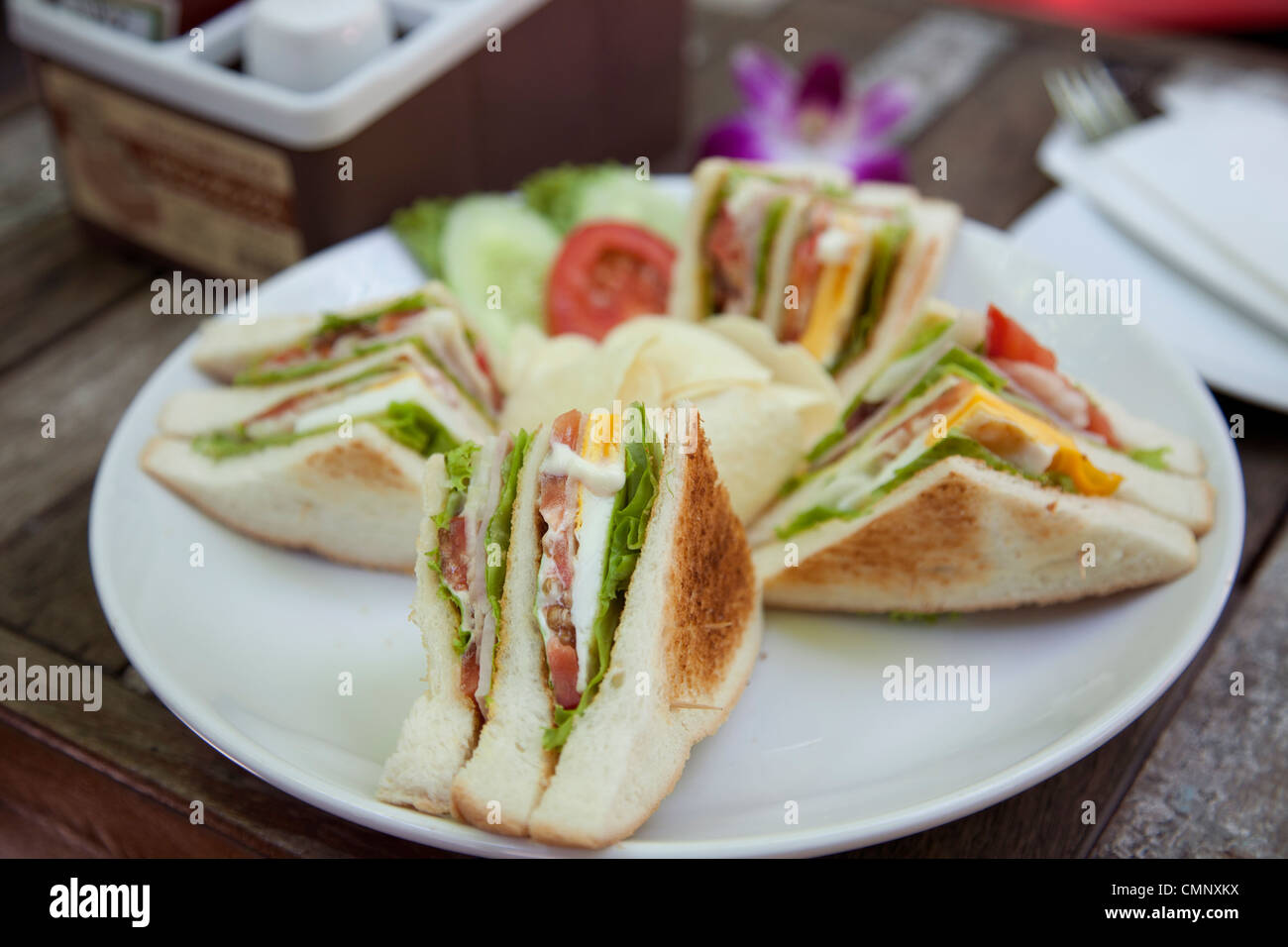 Club sandwich with coffee on wood background - Stock Image