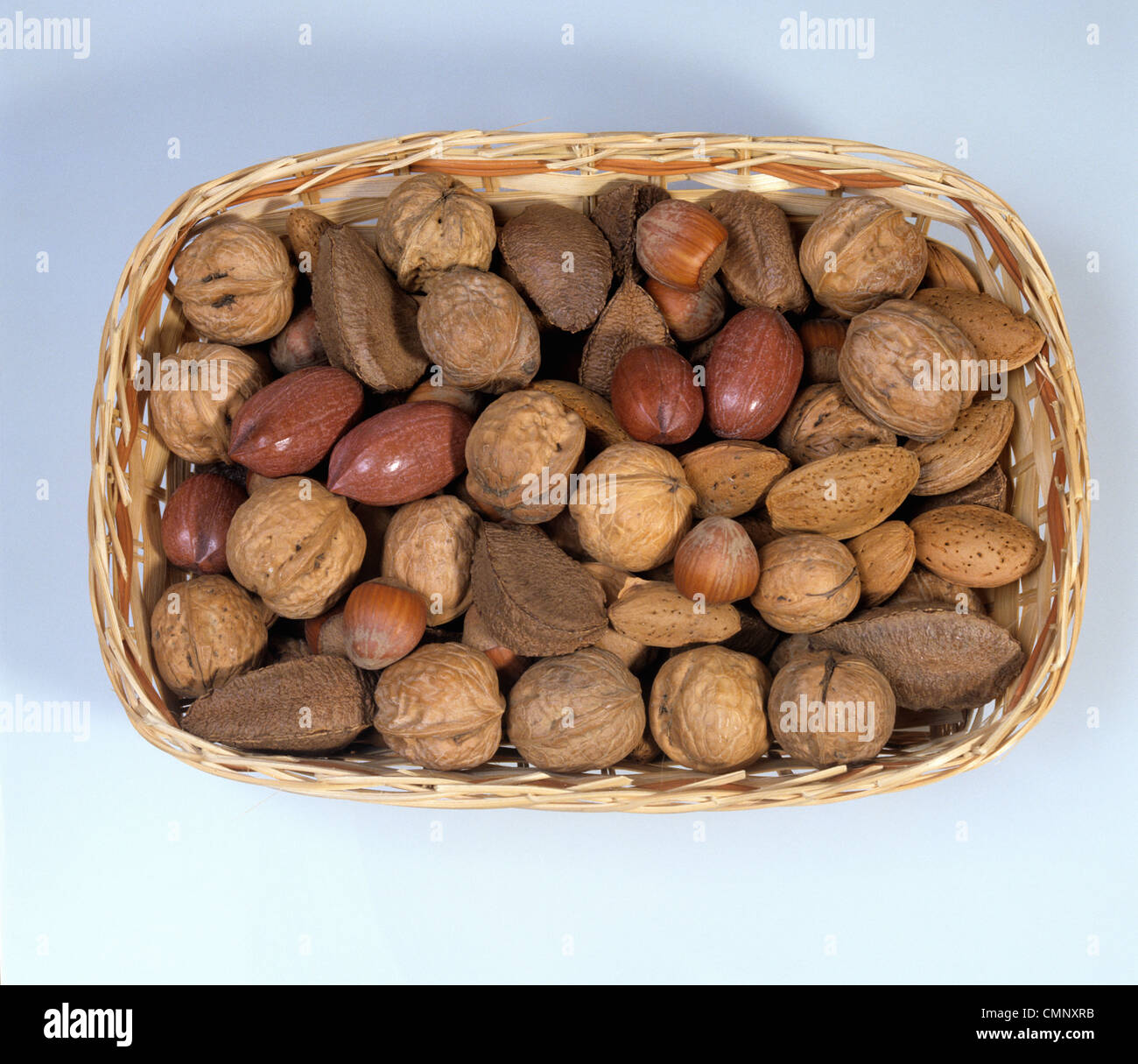 Mixed nuts in a presentation basket - Stock Image