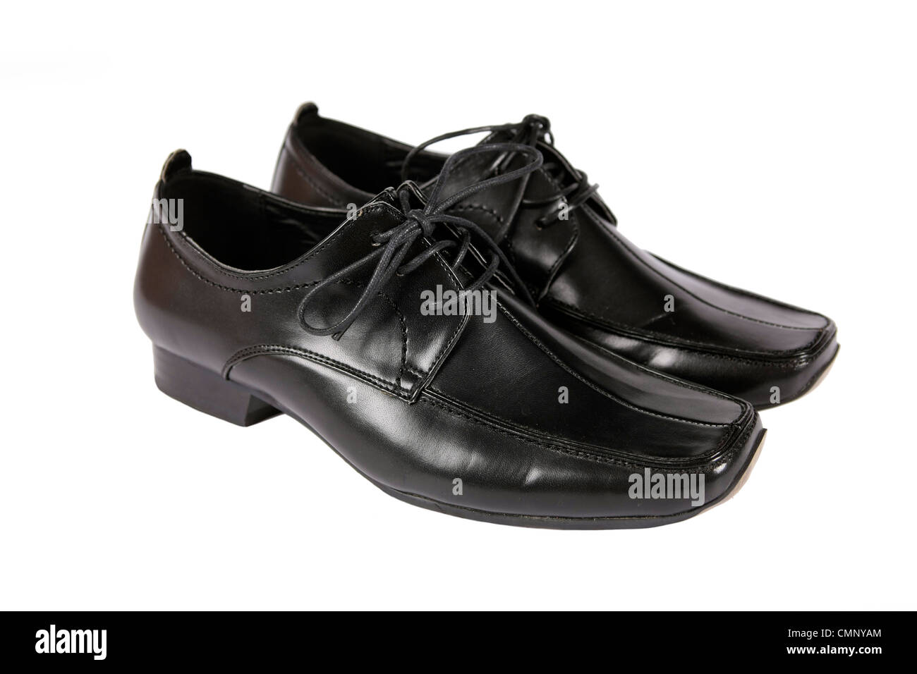 Man's Black dress shoes on a white background - Stock Image