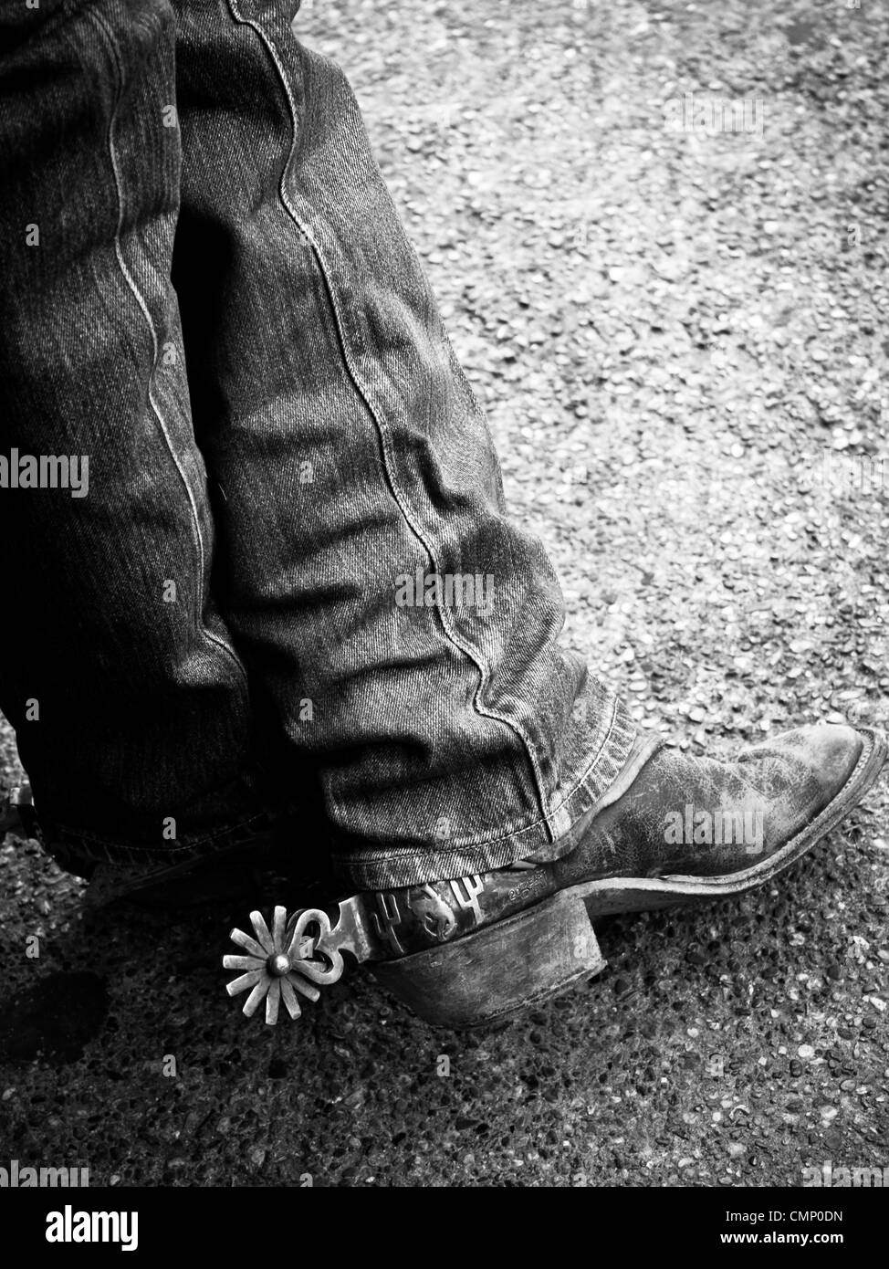 Close-up detail of cowboy boots and spurs. - Stock Image
