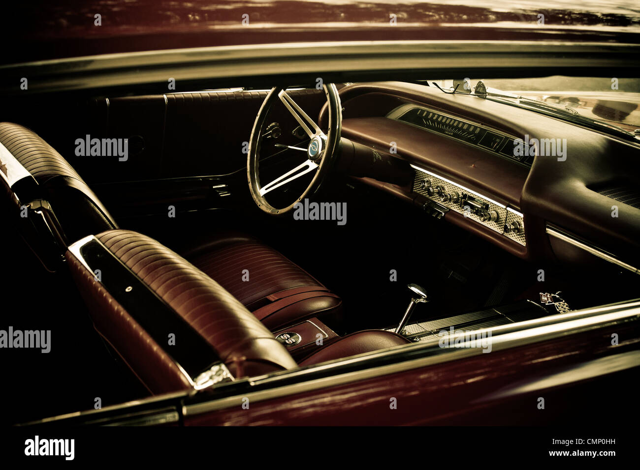 Moody image of classic car interior. - Stock Image