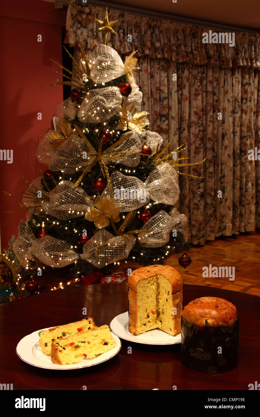 Christmas In Latin America.Whole And Sliced Paneton An Italian Fruit Bread Popular At